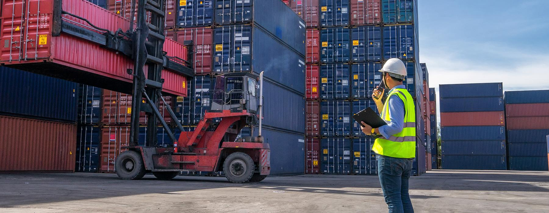 Image of containers with forklift truck