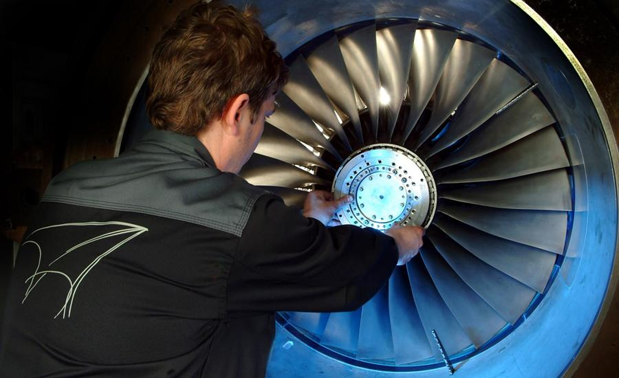 Man works on turbine at AneCom AeroTest